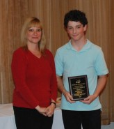Ronan McNally receives overall academic achiever award in mathematics and science from guidance counselor, Melanie Shaw.
